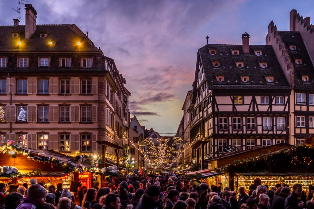 Strasbourg, France - December 8, 2013 - Crowds walk up Rue Merciere to the Christmas Market at dusk on December 8, 2013 in Strasbourg.