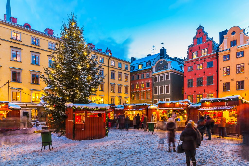 Beautiful snowy winter scenery of Christmas holiday fair at the Big Square (Stortorget) in the Old Town (Gamla Stan) in Stockholm, Sweden