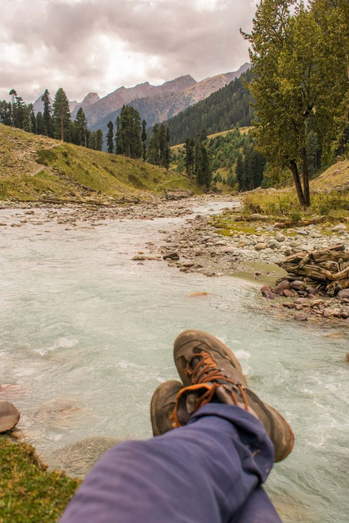 Relaxing by the stream on a Chadar Trek