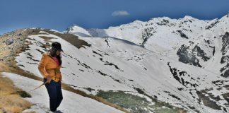 A woman trekking on snowcapped terrain - Chadar Trek