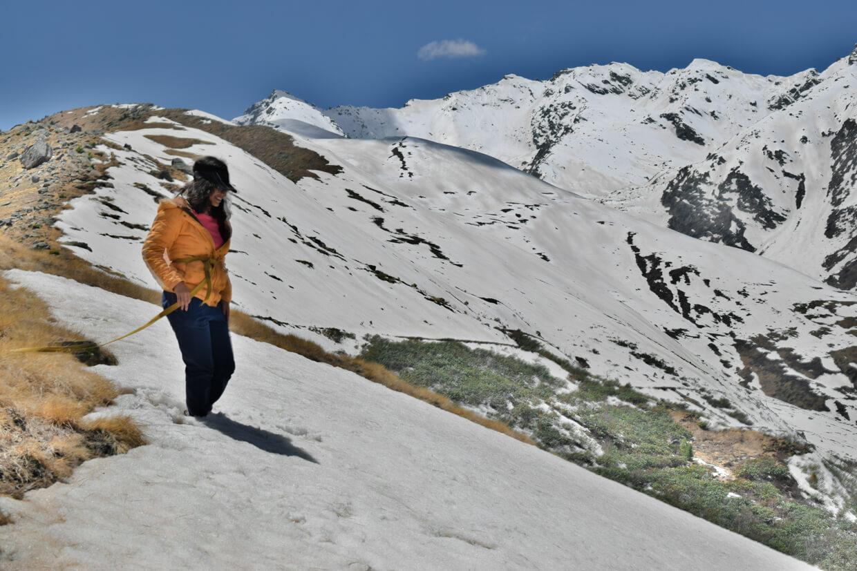 A woman trekking on snowcapped terrain - Chadar Trek