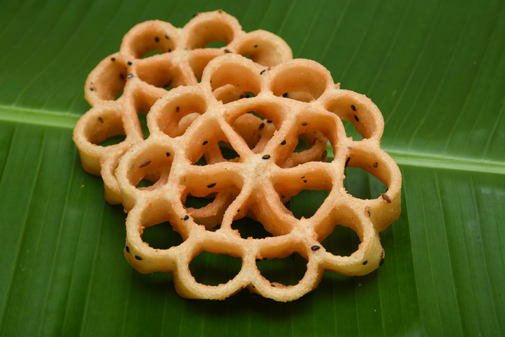 Achappam is a traditional and popular deep fried snack at tea time Kerala India during festive times like christmas, Onam, Vishu which is crunchy, mildly sweet in flower shape