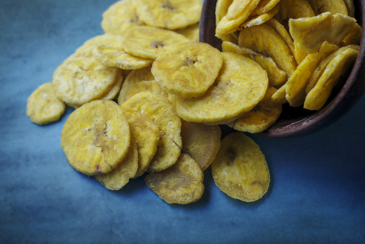 Banana chips in a bowl on table
