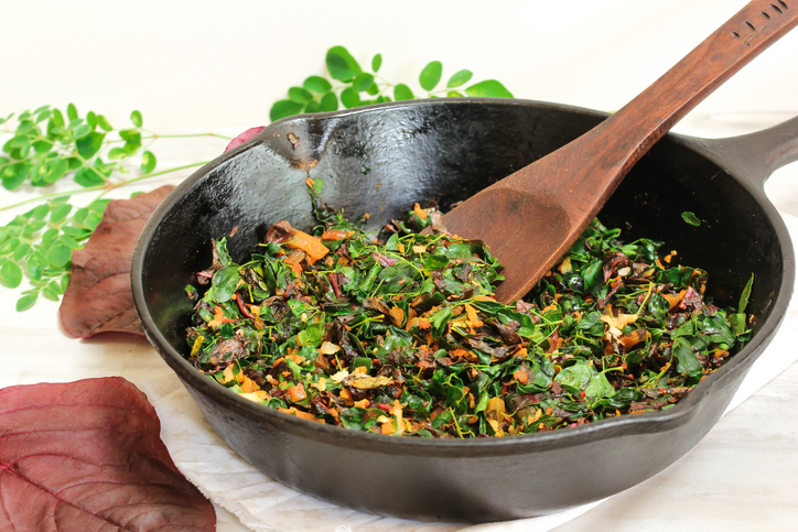 Moringa red Spinach stir fry/ Cheera Drumstick leaves Thoran, selective focus