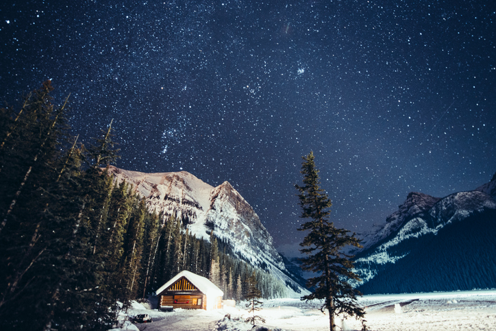 Starry Night over the frozen Lake Louise in winter, Banff National Park. Canada.