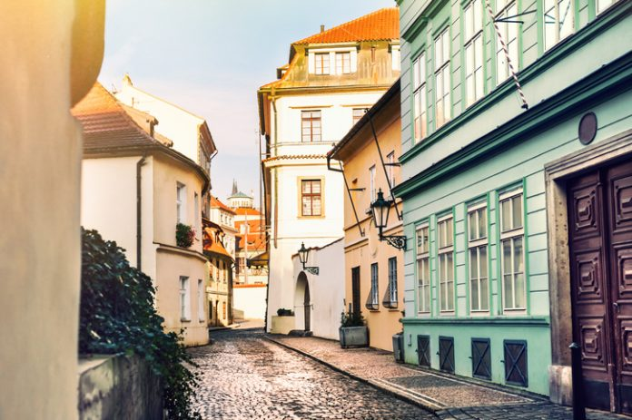 Beautiful street with old buildings in Prague, Czech Republic
