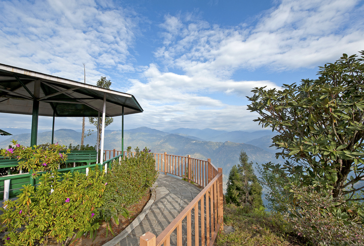 Himalayan view, Kalimpong, West Bengal, India. Rolling foothills and wide cloudscape in this Himalayan view from a quiet and tranquil viewpoint platform in Kalimpong, West Bengal, India