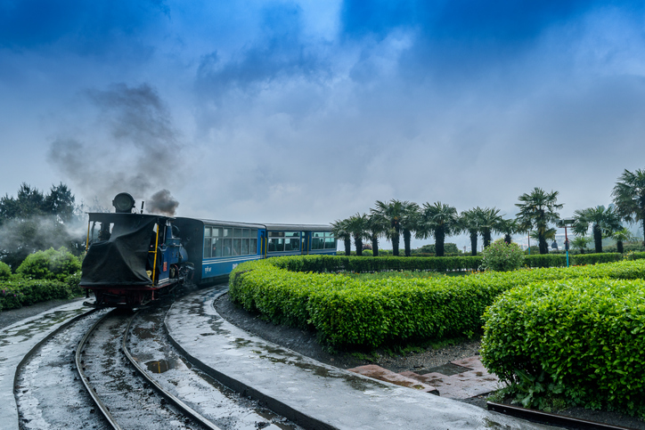 The Darjeeling Himalayan Railway, also known as the Toy Train, is a 2 ft narrow gauge railway,is entering to the Batasia loop,Darjeeling, west bengal, India. after a heavy rainfall.