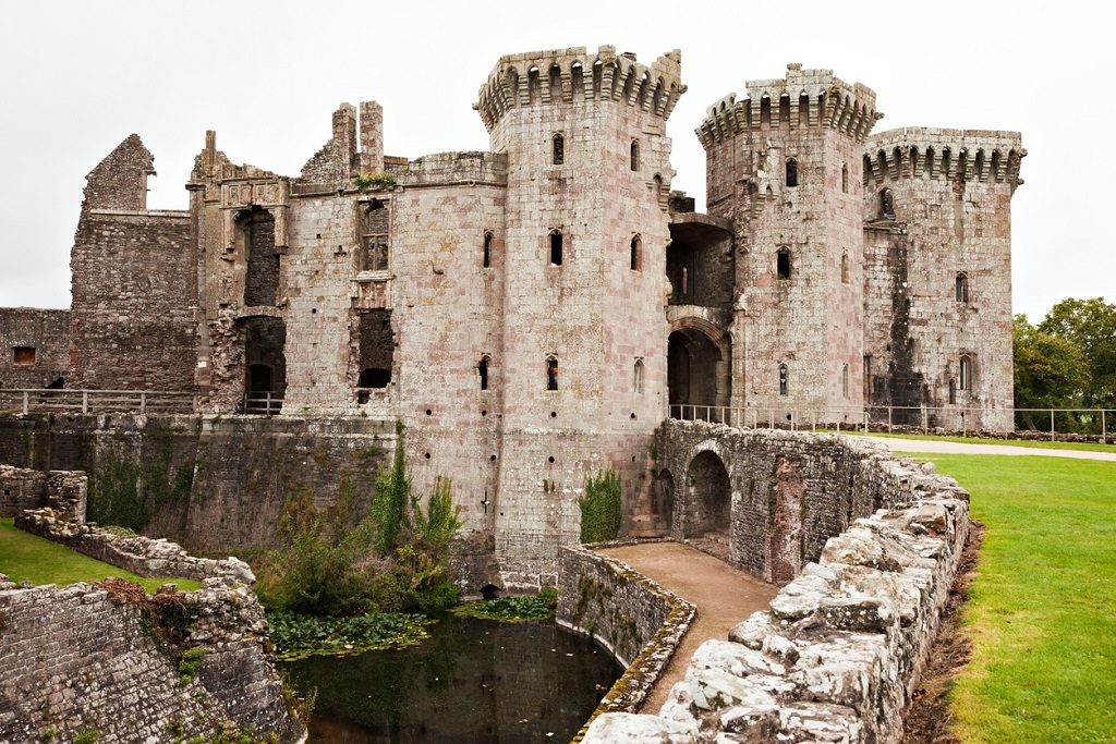 Ruins of the famous Raglan Castle in Wales. This view includes the moat and gatehouse.