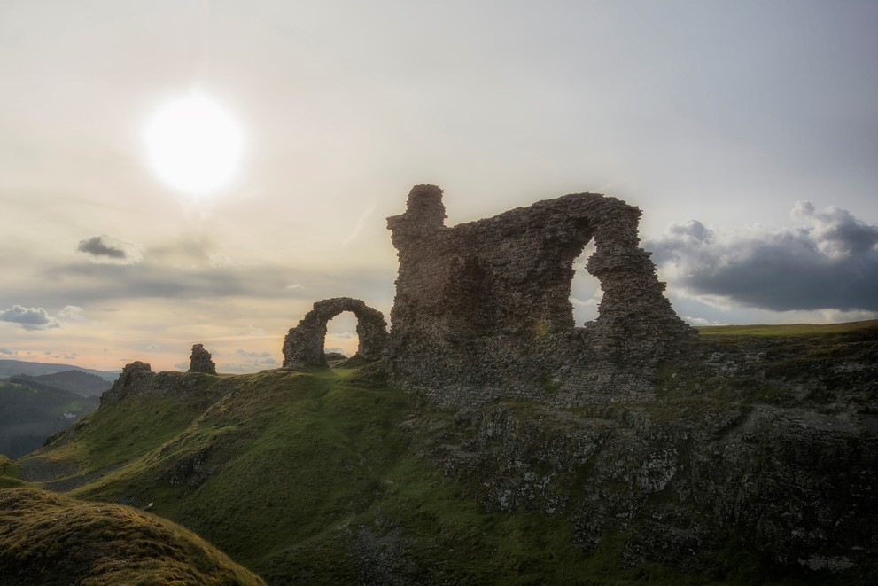 Castell Dinas Brân is a medieval castle standing high on a hill above the town of Llangollen in Denbighshire, Wales