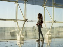 Mother and infant planning to board the flight