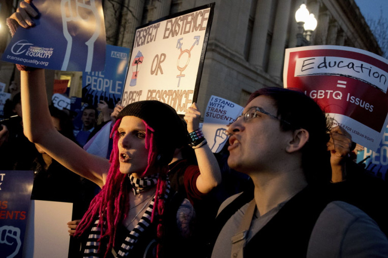 Activists and protesters with the National Center for Transgender Equality rally in front of the White House, Wednesday, Feb. 22.