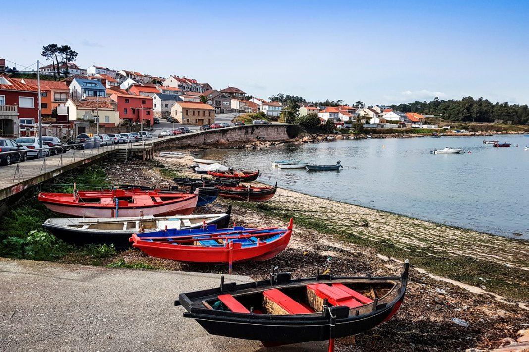 Fishing boats beached on Naval beach in Arousa Island, Galicia, Spain
