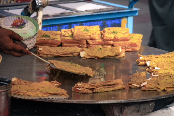 Indian street food, paranthas and fried bread in New Delhi