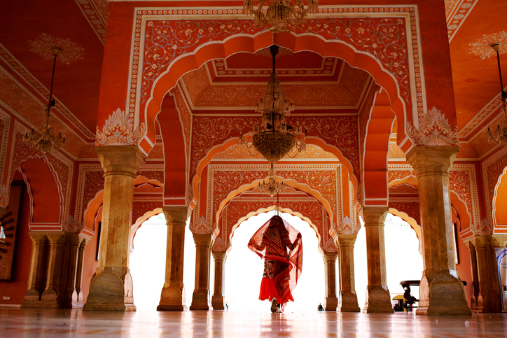 A woman traveling in Indian Palace, Budget Destinations