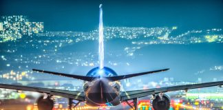 Aircraft on a lighted runway - rise in flight prices