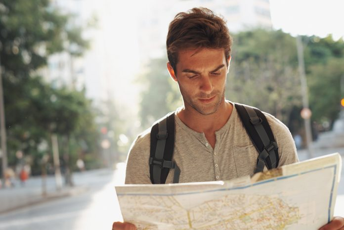 Cropped shot of a young man consulting a map while touring a foreign cityhttp://195.154.178.81/DATA/i_collage/pi/shoots/783379.jpg