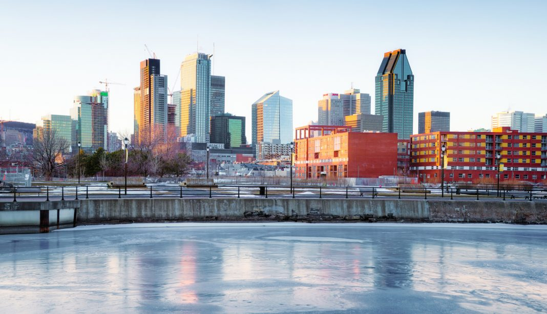 Downtown Montreal skyline in Winter from frozen Canal Lachine. Panoramic view composed with 10 images.