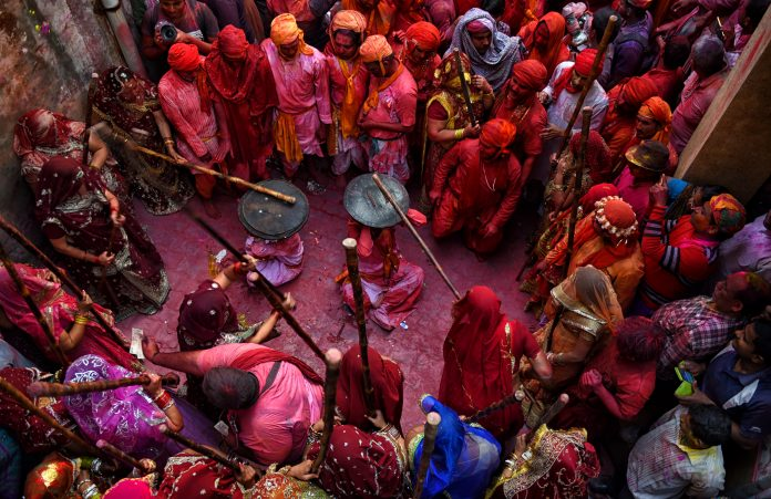 Lathmar Holi is an interesting part of the Holi Festival where Man from the nearby village are being beated by the Woman of Barsana as a part of the Traditional Mythology of Hindu culture.