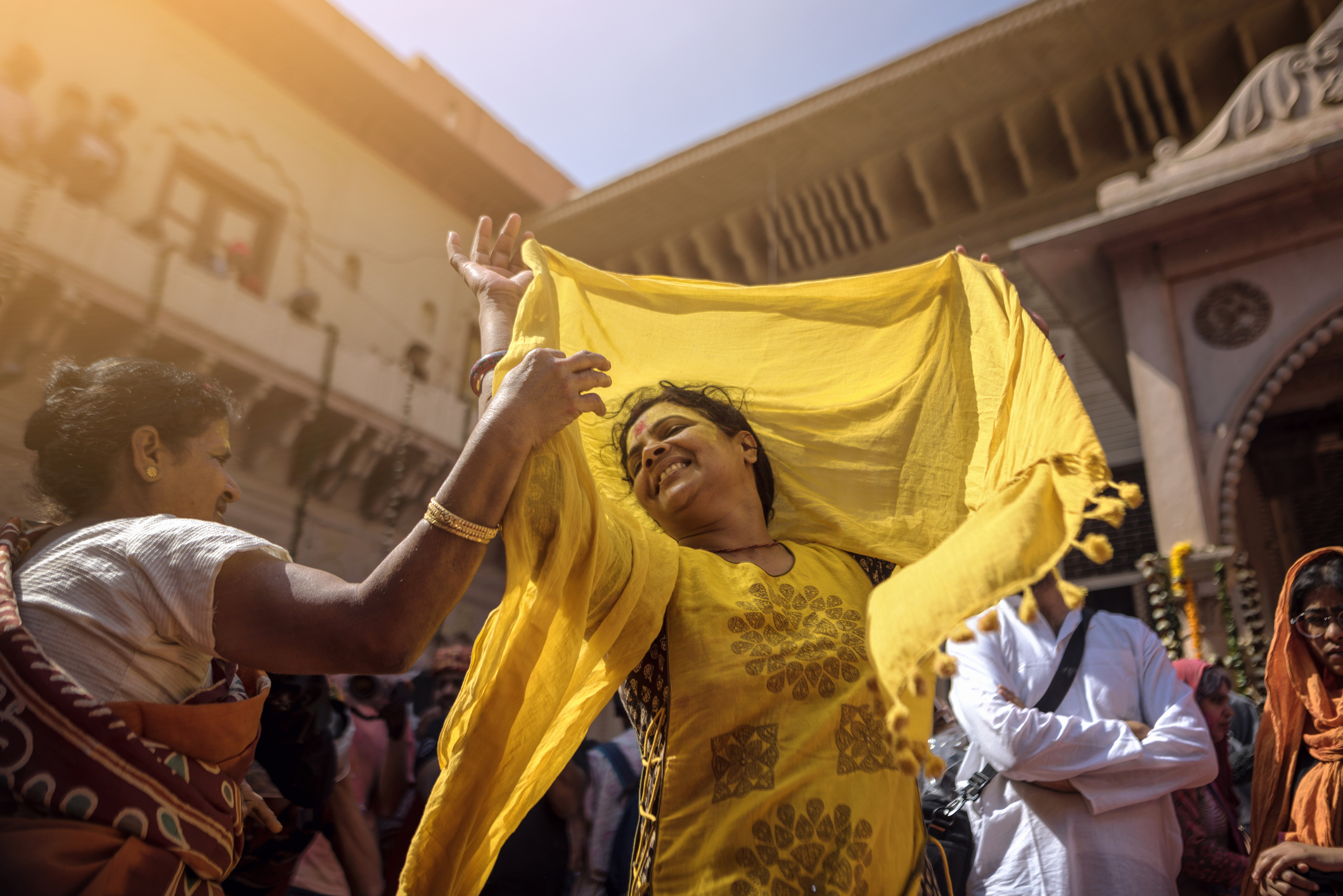 Vrindavan, Uttar Pradesh, India - Vrindavan in four-day Holi celebrations that began on February 24th.. Woman dancing on the tunes of Radhe Radhe during Holi celebrations in Vrindavan
