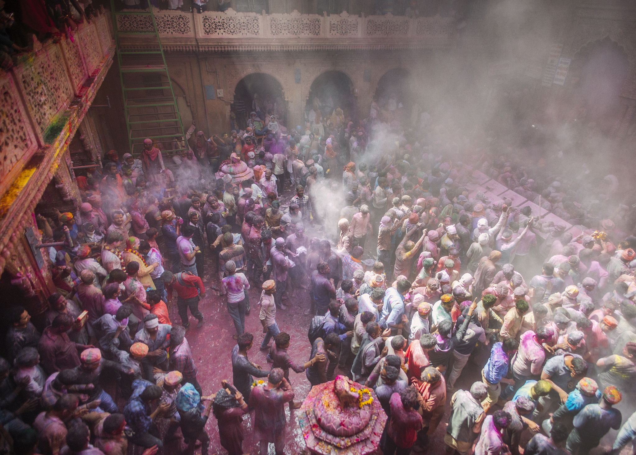Revelers throw colored powder and spray each other with water at Banke Bihari Temple in Vrindavan, northern India. Banke Bihari is famous for its extravagant multi-day Holi celebrations, attracting thousands of pilgrims and spectators from the rest of the country.