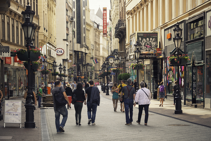 People walking on Vaci utca, a pedestrian only street known for its many stores and restaurants in central Budapest.