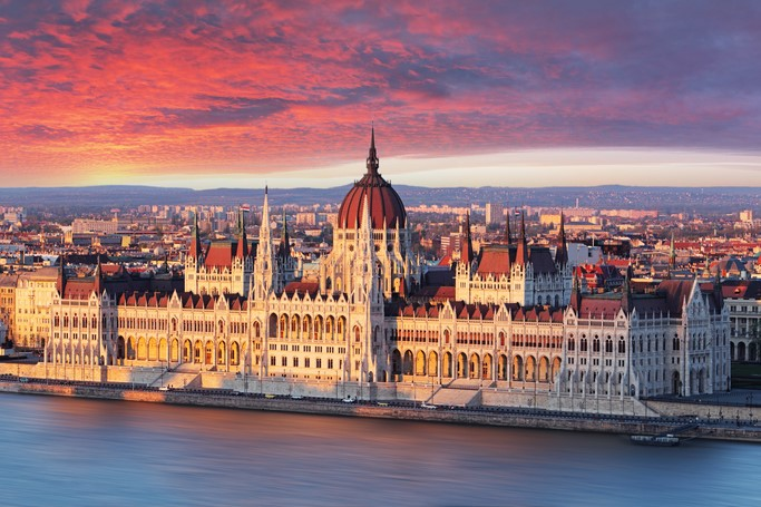 Architecture Lovers, Budapest parliament at dramatic sunrise