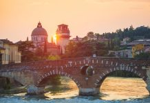 Ponte Pietra on Adige river in Verona old town, Italy.