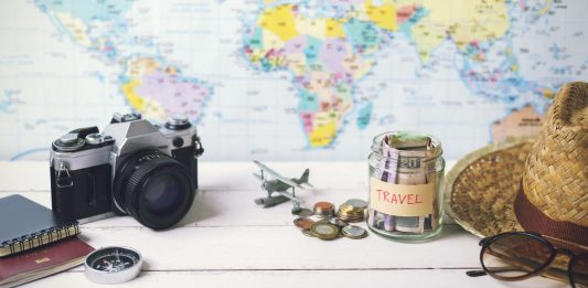 Collecting money for travel with accessories of traveler, Travel concept budget trips