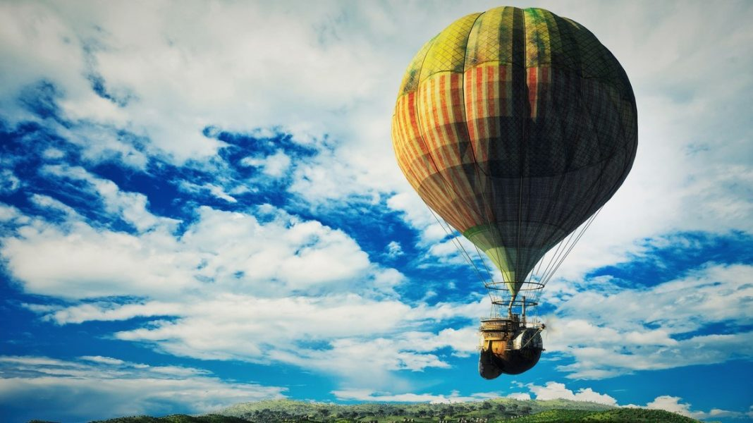 Fantasy landscape with flying steampunk balloon.