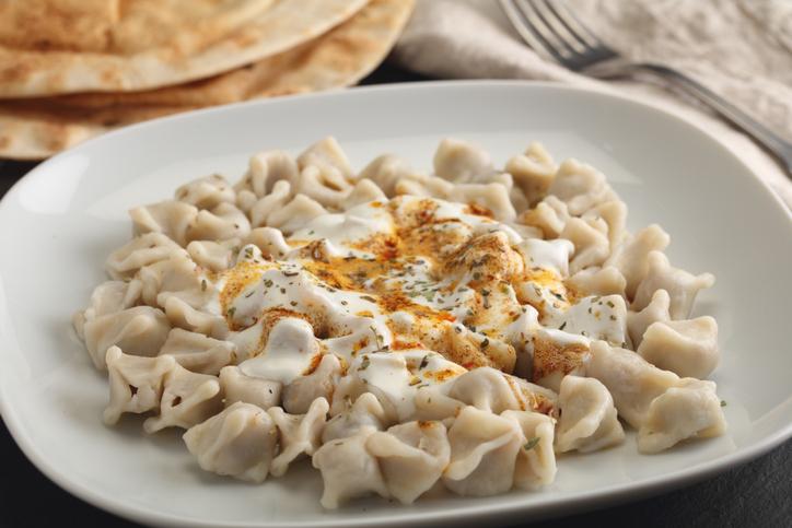 Turkish dumplings Manti with Greek yogurt and spices