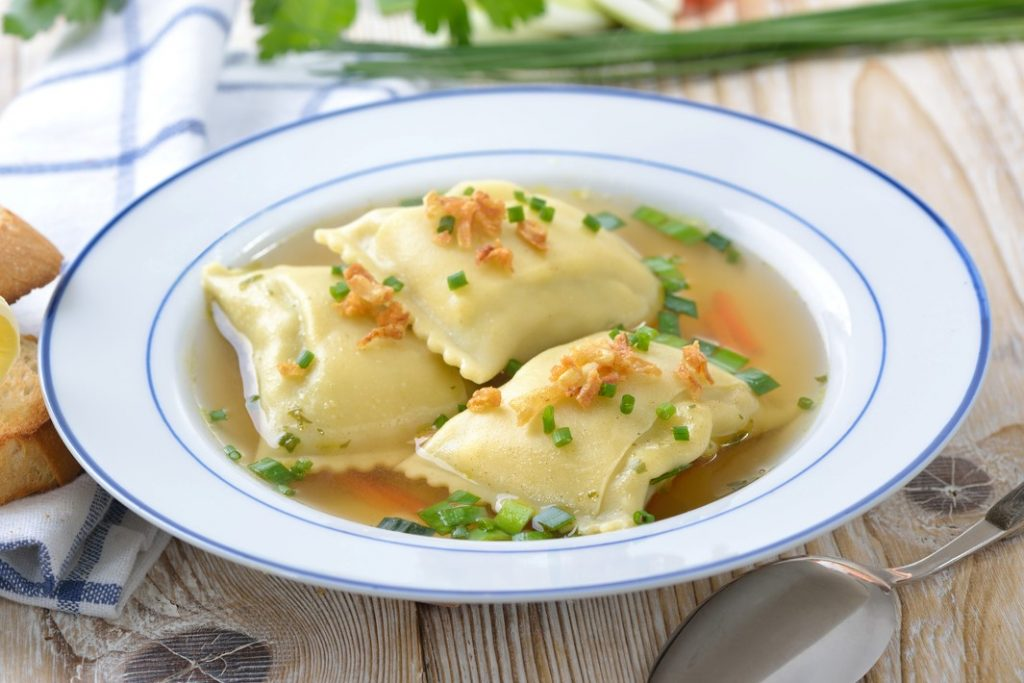 Vegetable broth with Swabian-style stuffed ravioli (so called 'Maultaschen') served with butter toast