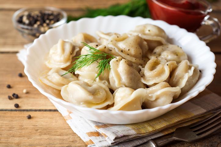 Russian meat dumplings pelmeni with dill