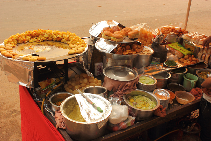 Street food stall with different chaat items in New Delhi, India.