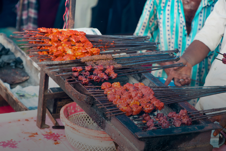 Image of chicken tikka in a heated grilled oven