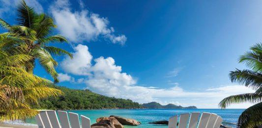 Beach chairs on tropical beach beat summer destinations