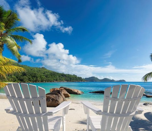 Beach chairs on tropical beach beat summer destinations