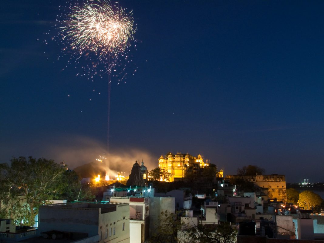 City Palace In Udaipur With Fireworks Before Holi Festival