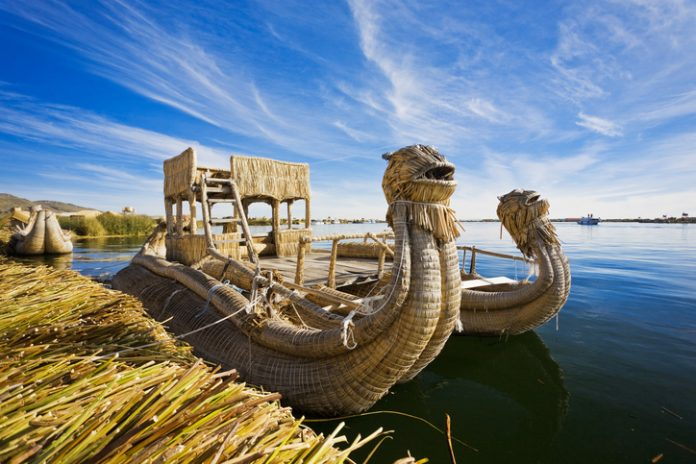 Reed Boat In Puno, Peru On Lake Titicaca The World's Highest Navigable Lake