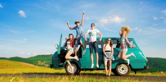 Young hipster friends on summer road trip on a summers day