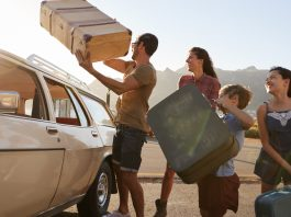 Nafplio, Family Loading Luggage Onto Car Roof Rack Ready For Summer Road Trip, Family Vacations