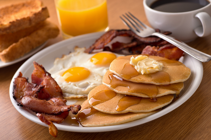 American Breakfast with bacon, eggs, pancakes, and toast
