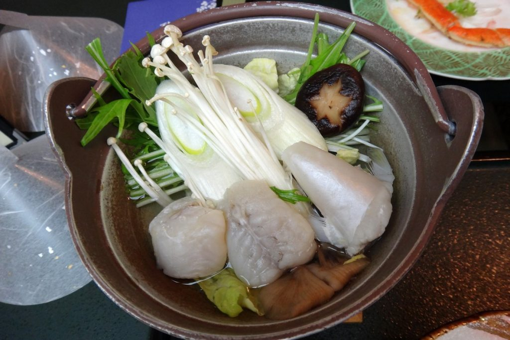 Japanese traditional seafood nabe soup with chops of Fugu in hot pot