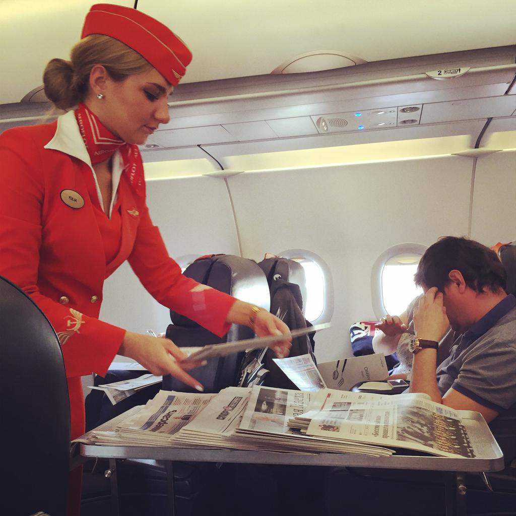 Stewardess serving passengers on board of Aeroflot flight