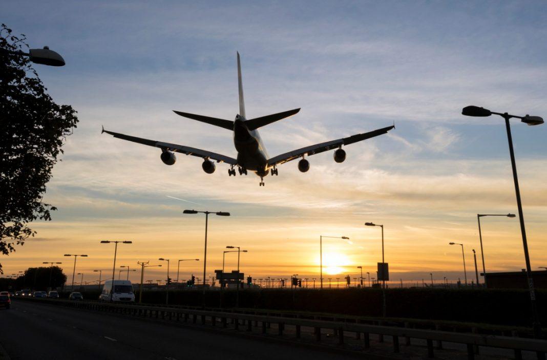 airplane landing in sunset, Maryland