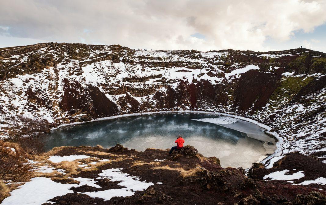 Crater Lakes, Traveler enjoying beautiful view at Kerio Crater with Lake in Iceland