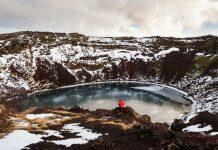 Traveler enjoying beautiful view at Kerio Crater with Lake in Iceland