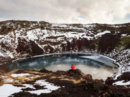 Crater Lakes, Traveler enjoying beautiful view at Kerio Crater with Lake in Iceland
