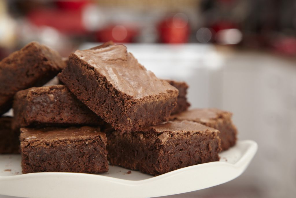 A batch of chocolate brownies on a plate