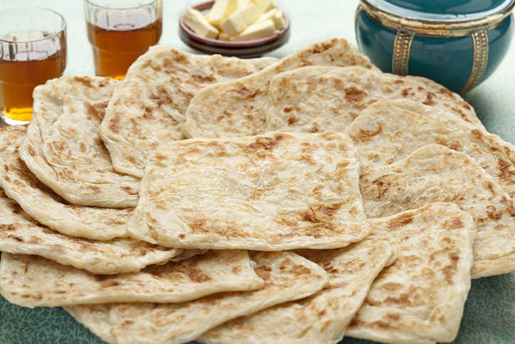 Fresh baked Moroccan square pancakes called Rghaif or Msemen closeup